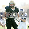 Rob Winner – rwinner@shawmedia.com<br /> <br /> Sycamore's Jordan Kalk carries the ball after an interception during the first quarter of a Class 5A playoff game in Sycamore, Ill., on Saturday, Nov. 5, 2011. Rochelle defeated Sycamore, 21-16.