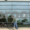 Kyle Bursaw – kbursaw@daily-chronicle.com<br /> <br /> Tommy Culver and Kevin Bischoff (right), of Chicago, take their bikes from the front of the Convocation Center after registering for the Bike MS: Tour de Farms on Friday, June 24, 2011.