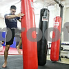 "Rob Winner – rwinner@daily-chronicle.com<br /> <br /> Mike ""Drama"" Ryan (center) uses a heavy bag during his circuit training routine on Tuesday night at United Mixed Martial Arts and Fitness in DeKalb."