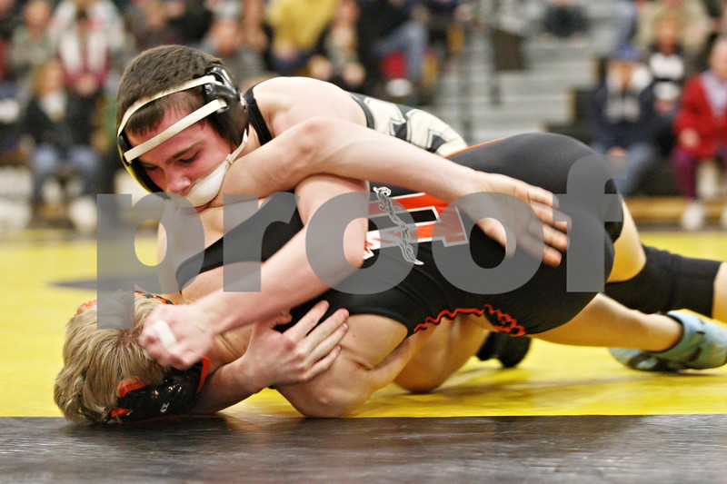 Rob Winner – rwinner@daily-chronicle.com<br /> <br /> Sycamore's Kyle Akins (top) and DeKalb's Patrick Martin wrestle in the 112-pound match on Thursday, Jan. 13, 2011 in Sycamore, Ill. Akins eventually pinned Martin.