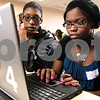 Kyle Bursaw – kbursaw@daily-chronicle.com<br /> <br /> Regina Council (left) and Talya Logan use a piece of software called Photo Story in a session, led by Tiffany Ryan, about the piece of software during the Technology Conference & Expo at NIU's Holmes Student Center on Saturday, April 9, 2011.