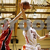 Rob Winner – rwinner@daily-chronicle.com<br /> <br /> Yorkville's Ryan Herron (left) blocks a shot by DeKalb guard Brian Sisler during the first quarter on Friday, Jan. 14, 2011 in DeKalb, Ill.