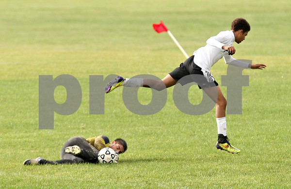 Rob Winner – rwinner@shawmedia.com<br /> <br /> Kaneland goalkeeper Marshall Farthing (left) makes a save before Sycamore's Aaron Massey can take a shot during the first half in Sycamore, Ill., on Tuesday, Sept. 27, 2011. Kaneland defeated Sycamore, 2-0.