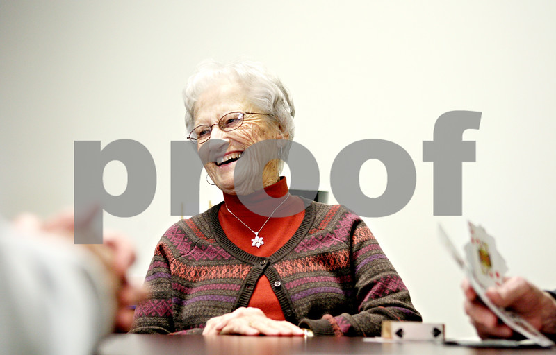 Rob Winner – rwinner@daily-chronicle.com<br /> <br /> Sandwich resident Sara Thurow enjoys a laugh while playing euchre with friends at the Fox Valley Community Center in Sandwich on Thursday afternoon.