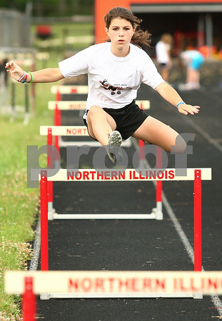 Kyle Bursaw – kbursaw@daily-chronicle.com<br /> <br /> Brenna Dupre, 11, of the Huskie Track Club, does some hurdles during practice at the old DeKalb High School on Thursday, July 7, 2011. Dupre hopes to qualify for the USATF national meet.
