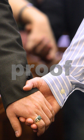 Kyle Bursaw – kbursaw@daily-chronicle.com<br /> <br /> People hold hands in the rows of seats in one of the courtrooms at the DeKalb County Courthouse in Sycamore, Ill. on Thursday, April 28, 2011. Hands Around the Courthouse was relocated inside due to the weather.