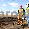 Kyle Bursaw – kbursaw@shawmedia.com<br /> <br /> Mike Keef (left) and Richard Larson, of the county highway department, look over their progress of extending the shoulder and widening the ditch on a section of Glidden Road south of Highway 64 and discuss their next steps at the end of their lunch break on Friday, Oct. 28, 2011.