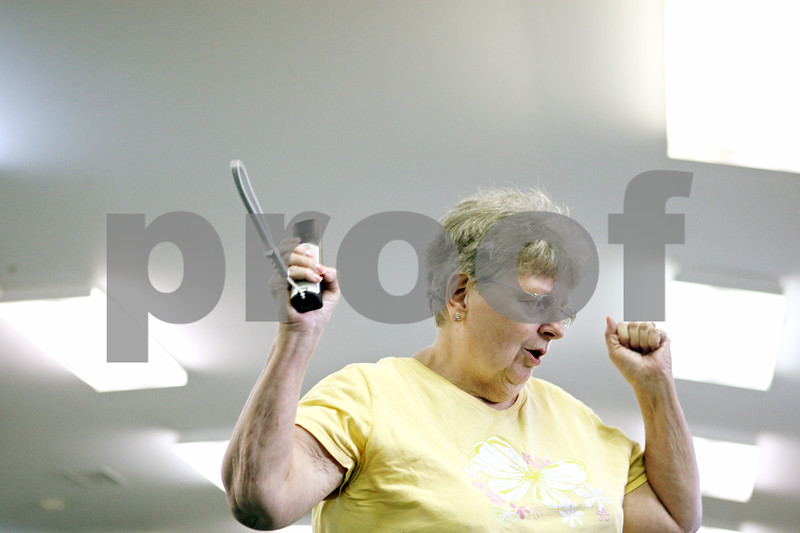 Rob Winner – rwinner@daily-chronicle.com<br /> <br /> Shirley Perkins, who was a substitute for the Sycamore Wii Strikers team, reacts after throwing a strike during a Wii bowling tournament at the Sycamore Park District Golf Clubhouse on Wednesday afternoon. The tournament is being hosted by the Family Service Agency.