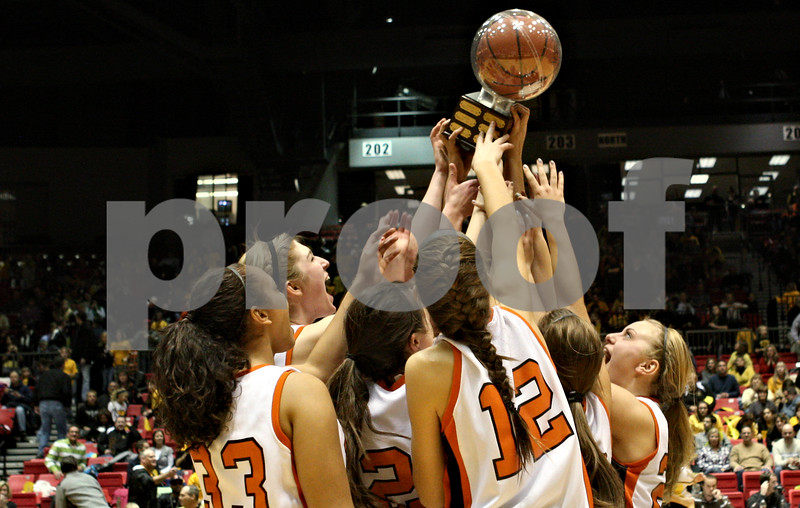 Rob Winner – rwinner@daily-chronicle.com<br /> <br /> The DeKalb girls basketball team celebrates their victory over Sycamore, 30-21, after Friday night's game at the Convocation Center in DeKalb, Ill., on Friday, January 28, 2011.
