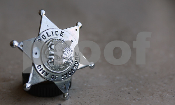 Kyle Bursaw – kbursaw@daily-chronicle.com<br /> <br /> A Sycamore police badge worn by Horace Fothergill for 28 years. Fothergill, was the Sycamore Chief of Police in 1940.<br /> <br /> Wednesday, June 29, 2011.