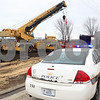 Kyle Bursaw – kbursaw@shawmedia.com<br /> <br /> A police vehicle at the scene of an accident involving a crane across the street from Genoa-Kingston High School on Tuesday, Dec. 6, 2011.