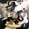 Kyle Bursaw – kbursaw@shawmedia.com<br /> <br /> DeKalb quarterback Brian Sisler fights for extra yards on a run in the second quarter of the annual DeKalb and Sycamore football game at Huskie Stadium in DeKalb, Ill. on Friday, September 9, 2011.