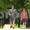 Kyle Bursaw – kbursaw@daily-chronicle.com<br /> <br /> Rick (center) and Keegan Smith, 10, walk their mixed lab Bella around the East Lagoon on the NIU campus on Friday, June 24, 2011.