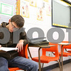 Kyle Bursaw – kbursaw@shawmedia.com<br /> <br /> Korey Gruskovak, a sophomore at Sandwich High School, writes his answer to a scenario about violence during a small health class at the school on Monday, Dec. 5, 2011. Gruskovak was in the Teens in Transition program during the previous school year.