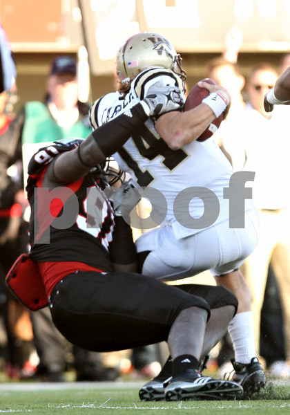 Rob Winner – rwinner@shawmedia.com<br /> <br /> Northern Illinois defensive lineman Anthony Wells (91) sacks Western Michigan quarterback Alex Carder (14) for a loss of nine yards during the third quarter in DeKalb, Ill., on Saturday, Oct. 15, 2011. Northern Illinois defeated Western Michigan, 51-22.