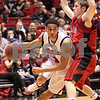 Kyle Bursaw – kbursaw@daily-chronicle.com<br /> <br /> Bryan Hall drives towards the basket past Ball State's Randy Davis during the first half of game between the Northern Illinois Huskies and the Ball State Cardinals. The Cardinals defeated the Huskies 75-70 on Saturday, Jan. 8, 2011.