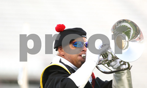 Kyle Bursaw – kbursaw@daily-chronicle.com<br /> <br /> A member of the Kilties from Racine, Wis. performs at Huskie Stadium during a drum and bugle competition on Saturday, July 30, 2011.