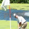 Kyle Bursaw – kbursaw@daily-chronicle.com<br /> <br /> Gene Kluber hits his ball up onto the green at the sixth hole of Indian Oaks Country Club in Shabbona, Ill. on Tuesday, July 12, 2011.