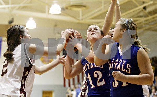 Rob Winner – rwinner@daily-chronicle.com<br /> <br /> Hinckley-Big Rock's Katie Hollis (12) tries to take a shot during the second quarter of the IHSA Class 1A H-BR Sectional final in Hinckley, Ill., on Thursday February 17, 2011. Hinckley-Big Rock went on to defeat St. Benedict, 63-25.