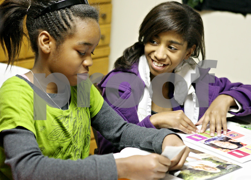 Rob Winner – rwinner@daily-chronicle.com<br /> <br /> Ashley Allen (left), 11, and Brianne Anderson, 11, work on a collage together at The Rock Christian Church in DeKalb before a presentation on Monday.