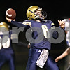 Rob Winner – rwinner@shawmedia.com<br /> <br /> On a fourth down play during the second quarter, Hiawatha quarterback Mike Mercado looks to throw to the end zone but the Hawks were unable to convert in Kirkland on Friday, Sept. 16, 2011.