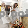 Rob Winner – rwinner@daily-chronicle.com<br /> <br /> Morgan Van Dee (left) and Megan Crague each pick up a flower before lining up for the start of the Sandwich Community High School commencement ceremony on Sunday in Sandwich.