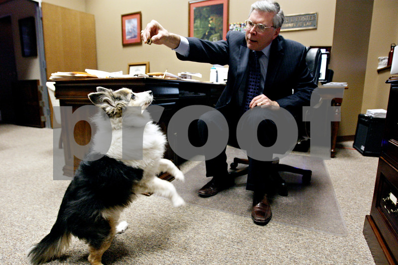Rob Winner – rwinner@daily-chronicle.com<br /> <br /> Keith Foster, of Foster & Buick Law Group LLC, gives a treat to his dog Charlie on Friday evening.