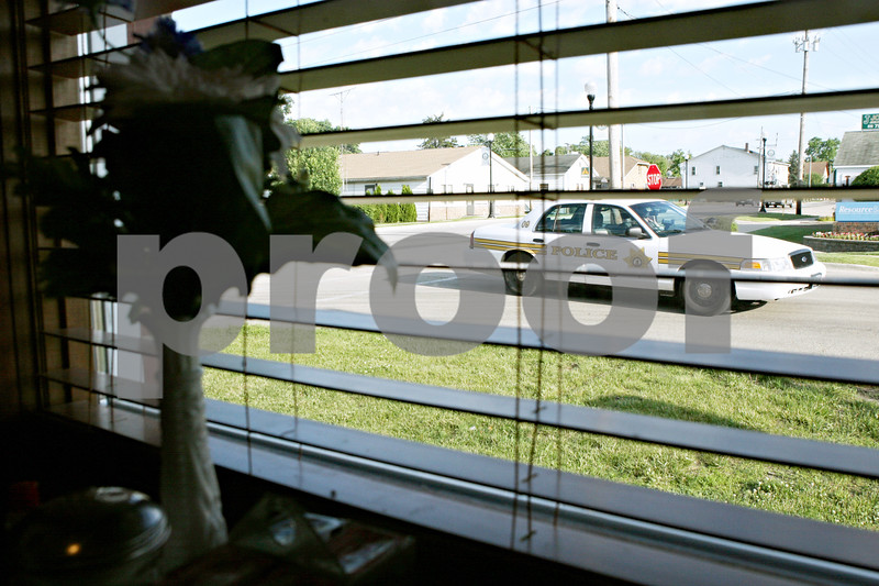 Rob Winner – rwinner@daily-chronicle.com<br /> <br /> From inside Sam's Family Restaurant a Cortland police car is seen traveling west on North Avenue near Somonauk Road on Thursday, June 16, 2011. The new county board district map approved by the county board splits Cortland into three districts that meet at the intersection of North Avenue and Somonauk Road.