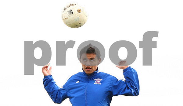 Kyle Bursaw – kbursaw@shawmedia.com<br /> <br /> Genoa-Kingston's Chris Camargo heads a ball while running drills at soccer practice on Monday, Oct. 17, 2011.