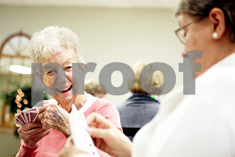 Rob Winner – rwinner@daily-chronicle.com<br /> <br /> Doris Waldrop, of Sandwich, plays a game of canasta with friends at the Fox Valley Community Center in Sandwich on Thursday afternoon.