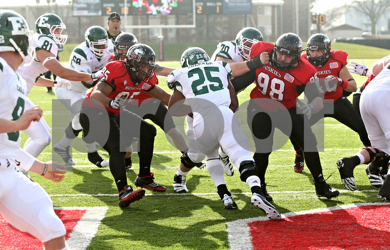 Rob Winner – rwinner@shawmedia.com<br /> <br /> Eastern Michigan running back Dominique Sherrer (25) takes a handoff and is met by Northern Illinois defensive end Sean Progar (95) in the end zone for a safety during the second quarter in DeKalb, Ill., on Friday, Nov. 25, 2011. Northern Illinois defeated Eastern Michigan, 18-12.