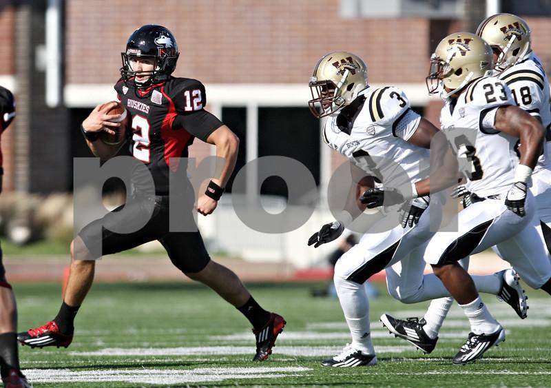 Rob Winner – rwinner@shawmedia.com<br /> <br /> Northern Illinois quarterback Chandler Harnish (12) carries the ball during the first quarter in DeKalb, Ill., on Saturday, Oct. 15, 2011. Northern Illinois defeated Western Michigan, 51-22.