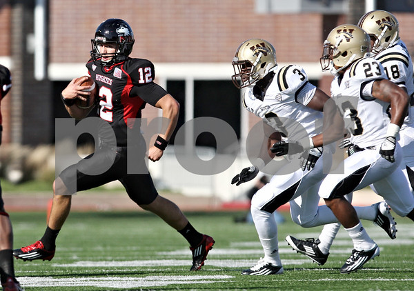 Rob Winner – rwinner@shawmedia.com<br /> <br /> Northern Illinois quarterback Chandler Harnish (12) carries the ball during the first quarter in DeKalb, Ill., on Saturday, Oct. 15, 2011. Northern Illinois defeated Western Michigan, 51-22.