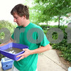 Kyle Bursaw – kbursaw@daily-chronicle.com<br /> <br /> Jon Bockman changes the water and refills the food for the mallards at Wild TAILS in DeKalb, Ill. on Thursday, July 21, 2011.