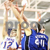 Kyle Bursaw – kbursaw@shawmedia.com<br /> <br /> Newark's Taylor Wright (center) pushes a rebound away from the outstretched arms of Genoa-Kingston foreward Adam Price (left) and to another Newark player during the third quarter of their game during the Plano Christmas Classic Tournament in Plano, Ill. on Monday, Dec. 26, 2011.