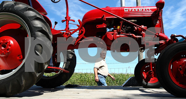 Kyle Bursaw – kbursaw@daily-chronicle.com<br /> <br /> Bill Diedrichs takes a look at his friend Don Joy's 1948 Farmall tractor as they get ready to unload it and park it for display at the Steam Show and Threshing Bee in Sycamore, Ill. on Wednesday, Aug. 10, 2011.