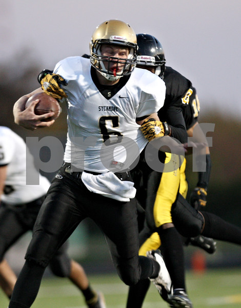 Rob Winner – rwinner@shawmedia.com<br /> <br /> Sycamore quarterback Ryan Bartels (6) carries the ball during the fourth quarter of a Class 5A playoff game in Chicago on Saturday, October 29, 2011. Sycamore defeated King, 36-29.