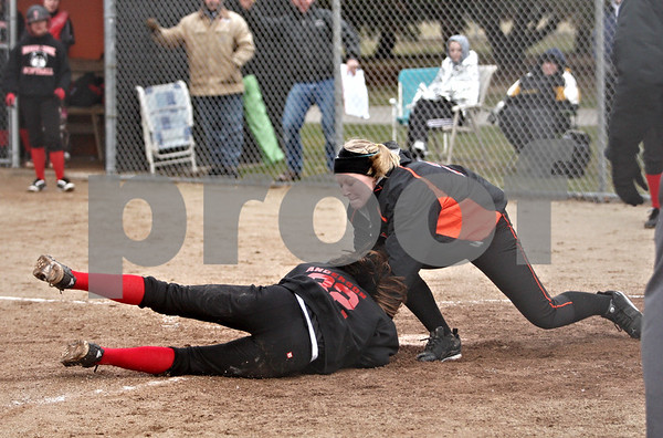 Rob Winner – rwinner@daily-chronicle.com<br /> <br /> Indian Creek's Lauren Anderson is tagged out at home by DeKalb's Mackenzie Johnson during the top of the second inning in DeKalb, Ill., on Wednesday, March 23, 2011. DeKalb went on to defeat Indian Creek in five innings, 16-4.
