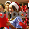 Kyle Bursaw – kbursaw@shawmedia.com<br /> <br /> Alyssa Peters (from left), Andrew Stratton, Abby Riddle and Anna Evans, all with the God Squad youth group, sing Christmas carols to residents at Oak Crest Retirement Center in DeKalb, Ill. on Wednesday, Dec. 14, 2011.