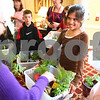 Kyle Bursaw – kbursaw@daily-chronicle.com<br /> <br /> McKenzie Bohlig (front and center) and other students from EarlyACT at North Grove Elementary give plants to residents of The Grand Victorian in Sycamore, Ill. on Tuesday, May 17, 2011.