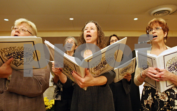 "Rob Winner – rwinner@shawmedia.com<br /> <br /> Before a Rosh Hashanah service at Northern Illinois University Holmes Student Center in DeKalb on Wednesday, members of the choir including Barbara Kaufmann (center) practice ""Mi Chamocha."""