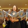 "Rob Winner – rwinner@shawmedia.com<br /> <br /> Before a Rosh Hashanah service at Northern Illinois University Holmes Student Center in DeKalb on Wednesday, members of the choir including Barbara Kaufmann (center) practice ""Mi Chamocha."""