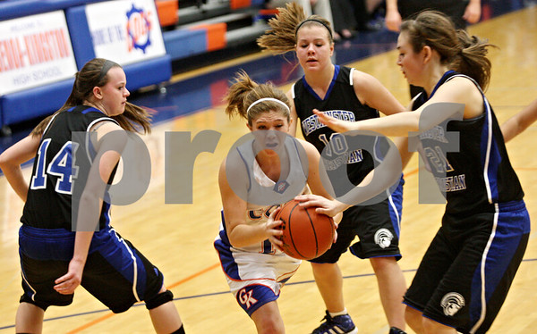 Rob Winner – rwinner@shawmedia.com<br /> <br /> Genoa-Kingston's Shannon Schumacher (center) tries to make a move to the basket during the fourth quarter in Genoa, Ill., on Saturday, Dec. 10, 2011. Westminster Christian defeated GK, 62-25.
