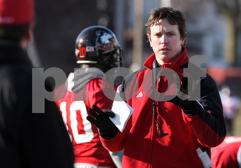 Kyle Bursaw – kbursaw@daily-chronicle.com<br /> <br /> Assistant coach Kevin Kane signals to be thrown a ball during practice at Huskie Stadium on Thursday, March 24, 2011.
