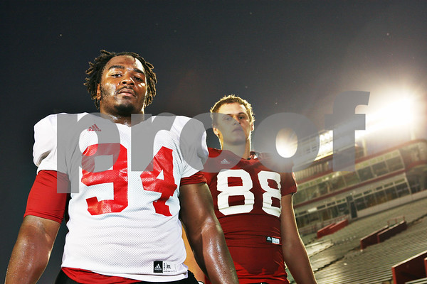 Rob Winner – rwinner@shawmedia.com<br /> <br /> Northern Illinois defensive tackle Donovan Gordon (94) and tight end Tim Semisch (88) in DeKalb, Ill. on Tuesday, Oct. 4, 2011.