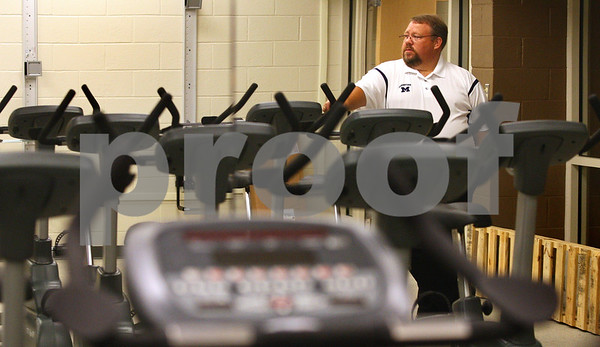 Kyle Bursaw – kbursaw@daily-chronicle.com<br /> <br /> Pictured in the mirror of Sycamore Middle School's new fitness lab, Principal Jim Cleven looks across the rows of the machines while giving a tour of the newly renovated building to the Daily Chronicle on Wednesday, Aug. 17, 2011. The school will have an open house for the public to see on Sunday from 2 to 4 p.m.