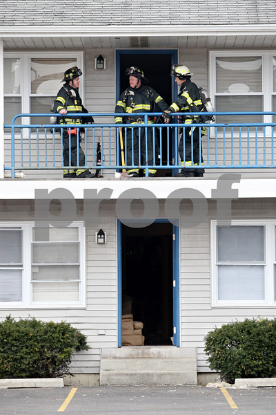 Rob Winner – rwinner@daily-chronicle.com<br /> <br /> Three DeKalb firefighters step outside an apartment unit on the 1000 block of Ridge Drive after a fire call on Monday afternoon.