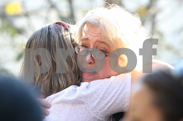 Rob Winner – rwinner@shawmedia.com<br /> <br /> Cindy Newman (right) is hugged after returning home from work to see her Genoa home in flames on Wednesday afternoon.