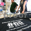 Kyle Bursaw – kbursaw@daily-chronicle.com<br /> <br /> PRISM members Lauren Pagan and Michael Sunderman wait at a booth to sell baked goods and t-shirts while celebrating the group's 41st anniversary at NIU on Wednesday, April 13, 2011. The t-shirts were for a Day of Silence on Friday, April 15, 2011.