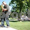 "Rob Winner – rwinner@shawmedia.com<br /> <br /> DeKalb resident David Thompson practices the guitar at Hopkins Park on Labor Day, Monday, Sept. 5, 2011. ""It's a really nice day and I wanted to play the guitar and I wanted to be outside so I came here,"" said Thompson."